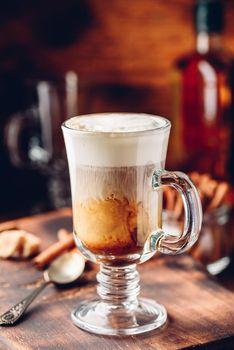 Irish coffee in drinking glass
