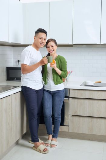 Full-length image of romantic couple at home