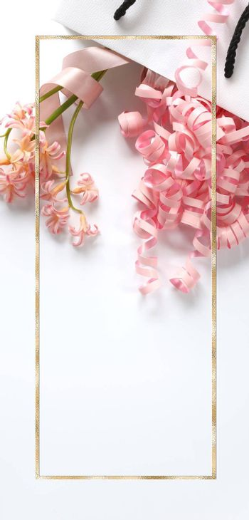 Pink spring flowers, pink gift streamers in white gift bag on white background. Beautiful spring card for Birthday, Woman, Valentines, Mothers Day in pastel colours. Vertical flat lay. Copy space