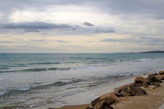 Cloudy day on the beach in winter in La Marina, Alicante