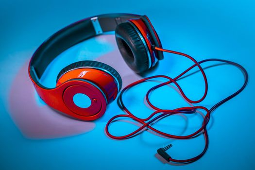 Red Headphones on Blue Background