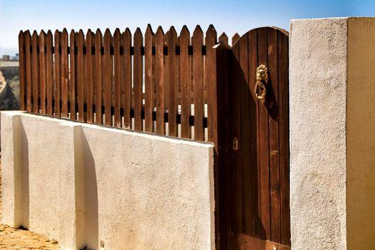 Wooden fence Vintage door knocker lion shaped on brown wooden door