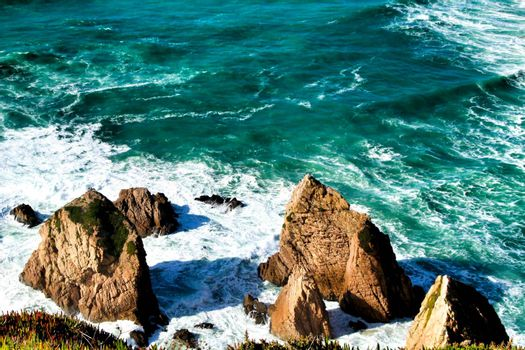 Beautiful Ursa beach with its colossal rock formations and the blue Atlantic Ocean
