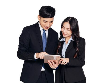 successful asian young business man and woman looking at tablet