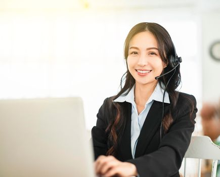 Business woman in headphone and working  in home office