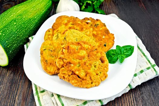Flapjack chickpeas with zucchini in plate on dark board