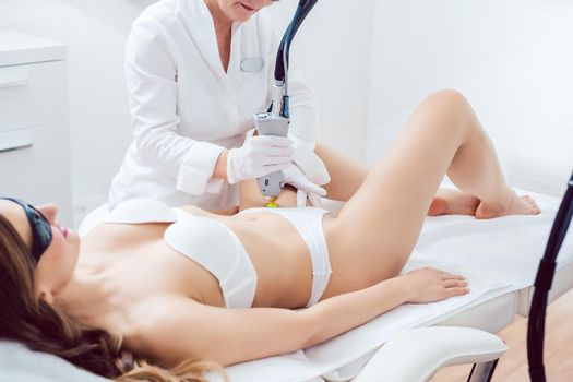 therapist using painless laser technology for hair removal