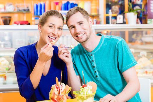 Couple enjoying a sundae in the ice cream parlor