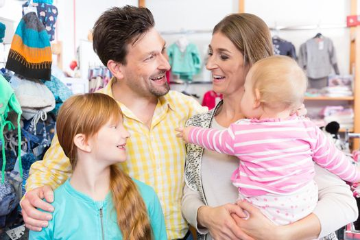 Happy family in the retail store