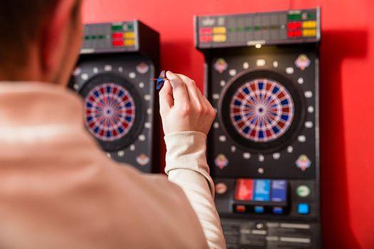 Man aiming at dartboard
