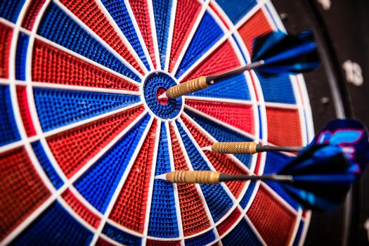 Blue arrows on dartboard