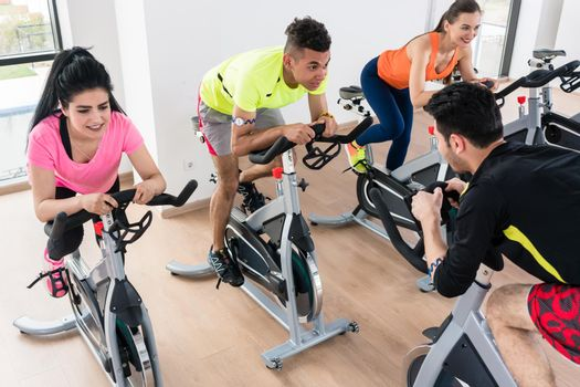 High angle view of a people exercising on bicycle in gym