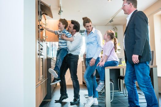 Family looking at a new kitchen in the showroom
