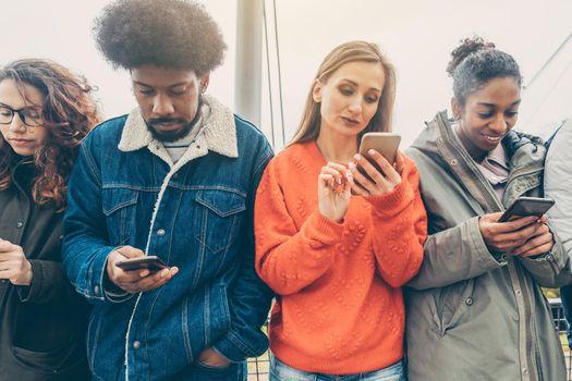 People choosing their phones over personal interaction
