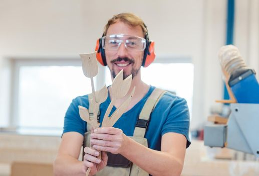 Carpenter doing woodworks for Easter or mothers day