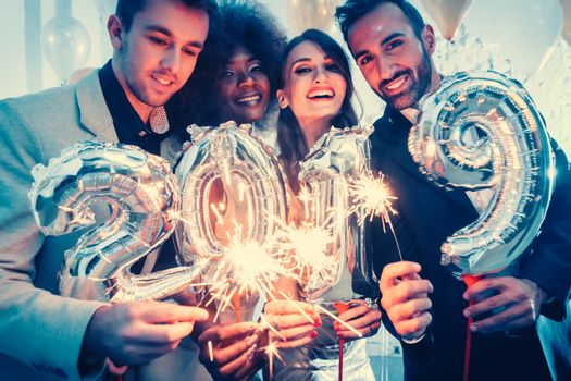 Group of party people celebrating the arrival of 2019