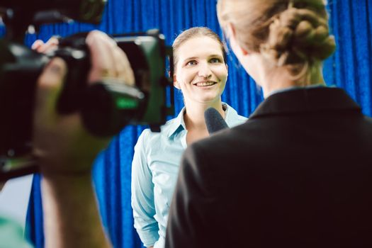 Reporter in an interview with a celebrity