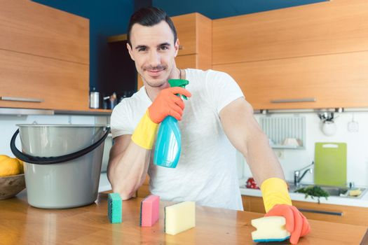 Man is proud of doing the chores