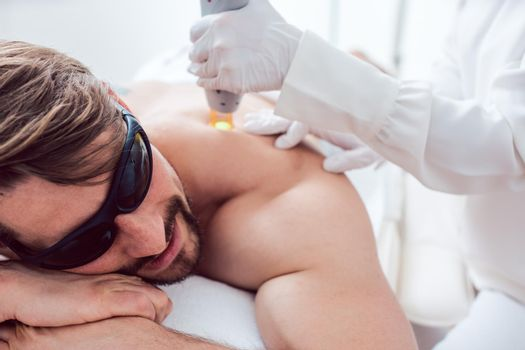 Man in a hair removal studio