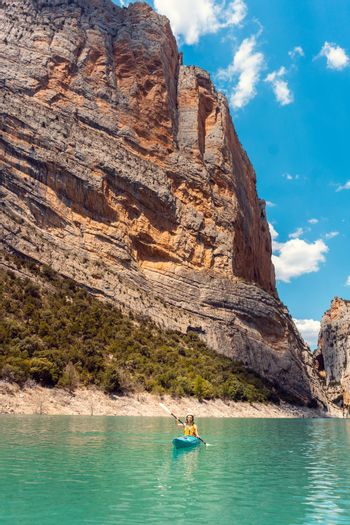 Woman on a kayak in the Pyrenees mountains in Catalonia