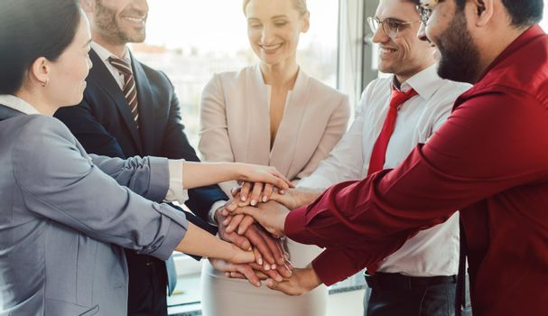 Diversity team of business people in kick-off meeting