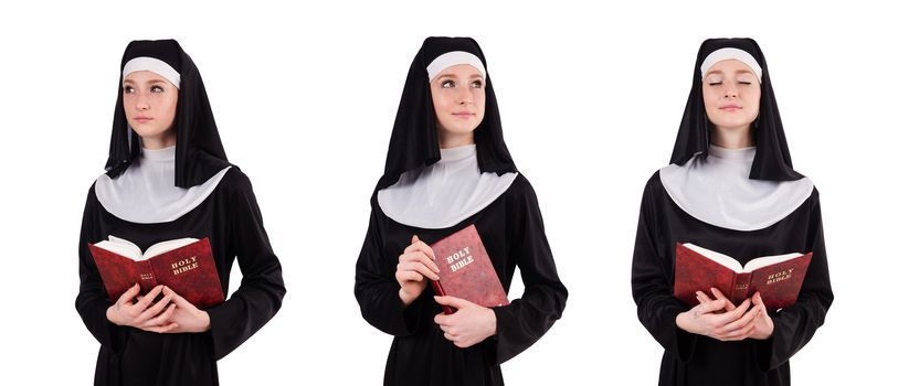 Young nun with bible isolated on white