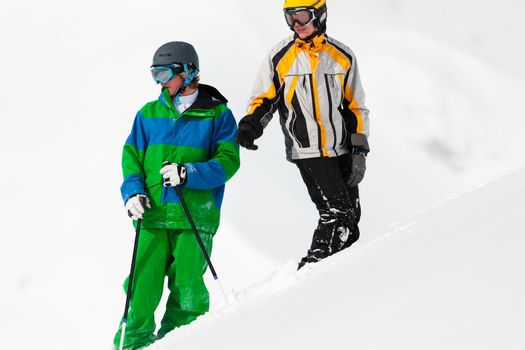 Skier and snowboarder in the snow