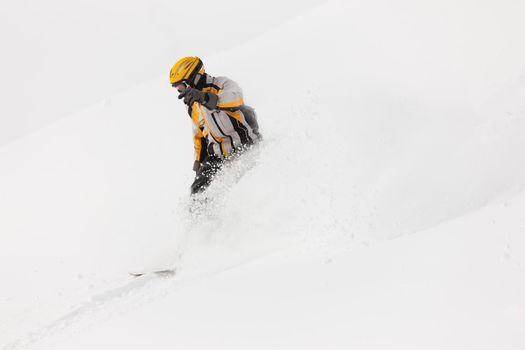 Snowboarder skiing downhill