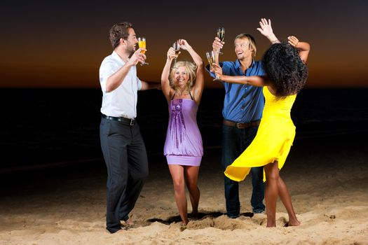 Party and dancing at the beach