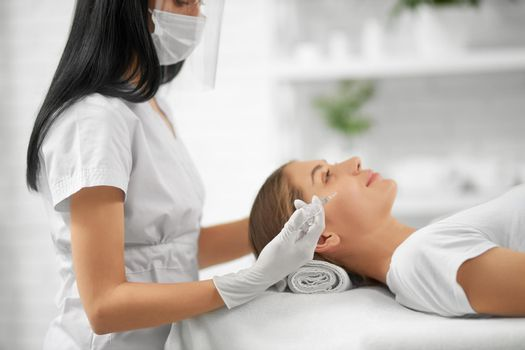 Woman in doing procedure for improvements face skin.