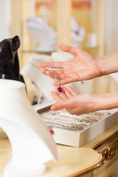 Female jeweller presenting jewellery