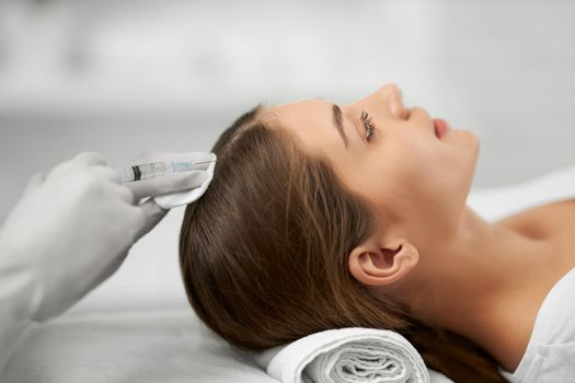 Beauty procedure for growth hair in professional salon.