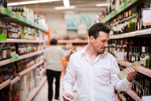 Shopper Holding Liquor Bottle