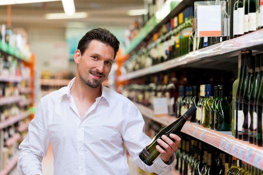 Young Man Shopping for Liquor