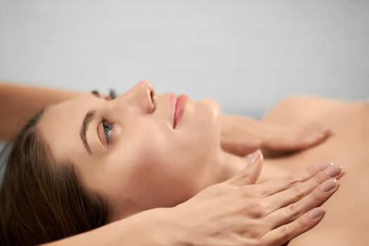 Young woman on procedure massage neck.