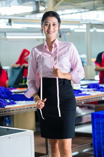 Asian dressmaker in a textile factory