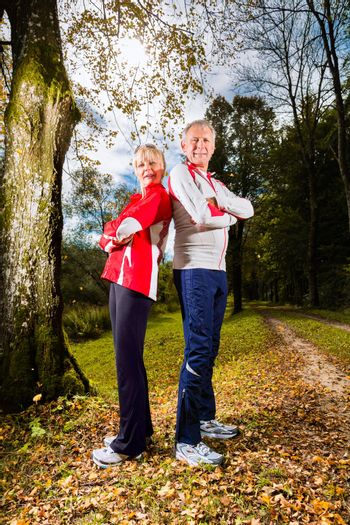 Seniors sports training on a forest road