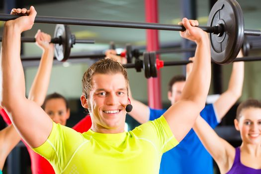 weight training in the gym with dumbbells