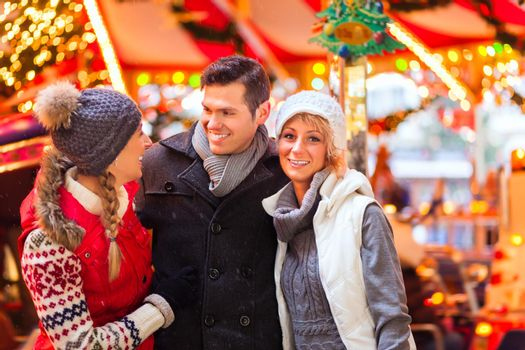 Friends during  the Christmas market or advent season