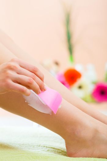 Woman in Spa getting a hair removal