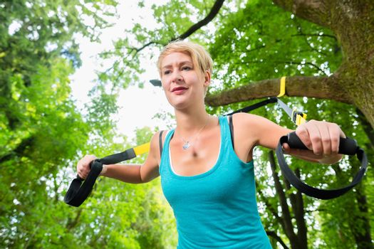 woman doing suspension sling trainer sport