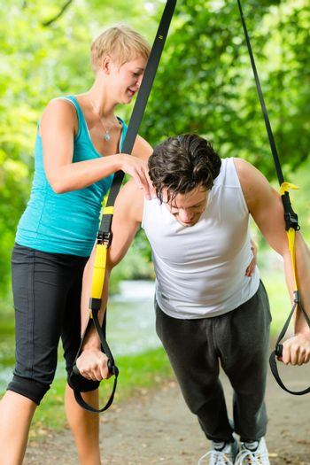 People doing suspension or sling trainer fitness