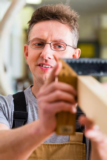 Carpenter with angle in carpentry