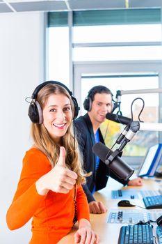 radio presenters in radio station on air