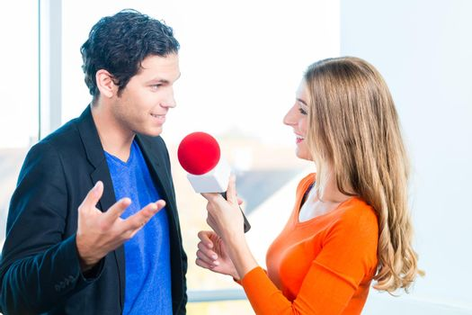 Radio host in radio stations with interview
