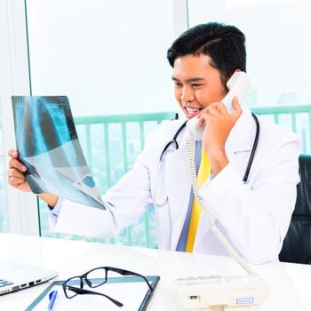 Asian doctor diagnosis radiograph in practise