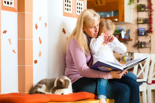 Mother reading night story to kid at home