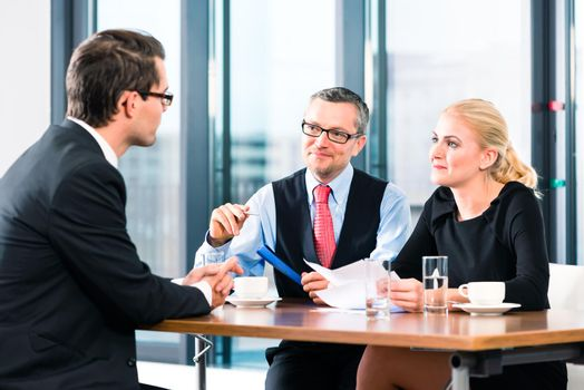 Business - Job Interview and contract signing