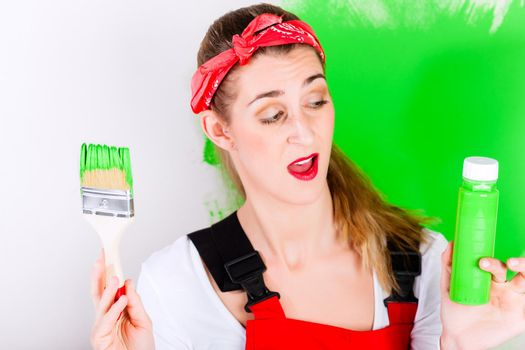 Woman at home improvement and painting