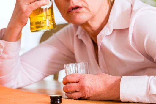 Female alcoholic drinking hard liquor